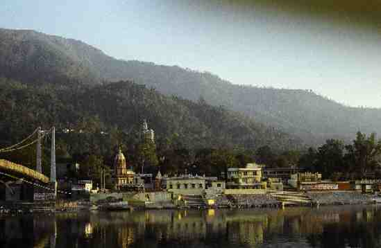 Lakshman Juhla spans the Ganges to the famous Swargashram. White peaked building in background is the Kailashanand Mission.